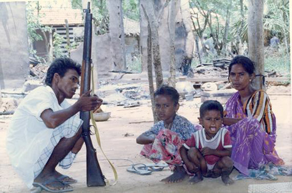 A file picture of a Muslim family whose hut was torched during the Tamil rebel attack on Palliyagodella village.