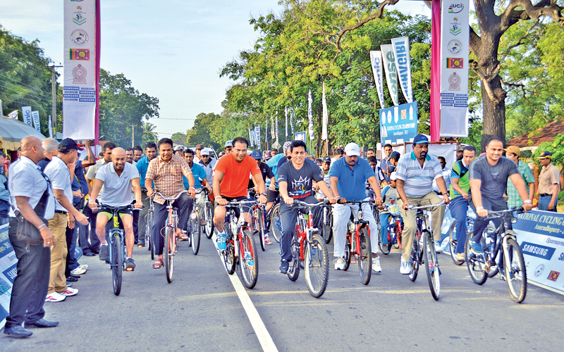 "Sports Minister Dayasiri Jayasekara, Agriculture Minister Duminda Dissanayake participating in the ""Cycling for all"" event. North Western Province Chief Minister Peshala Jayaratne, Minister for Rural Development P. Harrison, North Western Province Sports Minister S.M.Ranjith also joined the ride which was worked off on a 14.67 km long circuit."