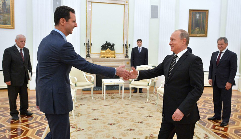 Russian President Vladimir Putin, (R) shakes hand with Syrian President Bashar Assad in the Kremlin in Moscow, Russia on October 20, 2015.