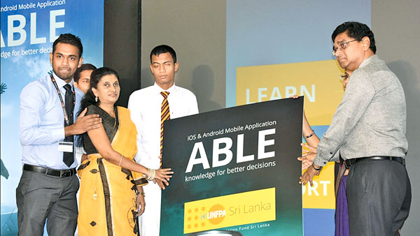 Project Coordinator Arun Jentrick, Disability Resource Centre Head Manique Guneratne, student Harshan Nilukul and UNFPA's Prem Perera launching the mobile app
