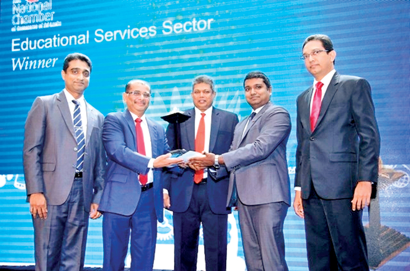Nishan Sembacuttiaratchy, Chief Executive Officer (CEO), ESOFT Metro Campus, receiving National Business Excellence Awards 2015. Dr. Dayan Rajapakse, Group Managing Director, ESOFT Metro Campus,(Right corner) and Upul Dassanayake, General Manager, ESOFT METRO CAMPUS (Left corner) also are in the picture.