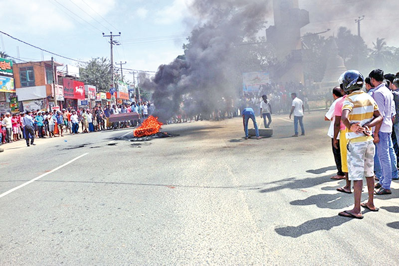 People in Embilipitiya staged a massive protest blocking roads and setting fire to tyres in Embilipitiya with the death of a youth following a clash with Police.
