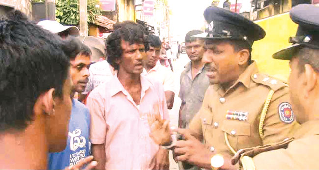 A police officer explaining the situation to protestors
