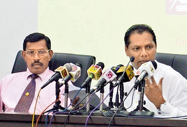 Sports Minister Dayasiri Jayasekara is briefing to media. Additional Secretary (Development) Saman Bandara is also present.
