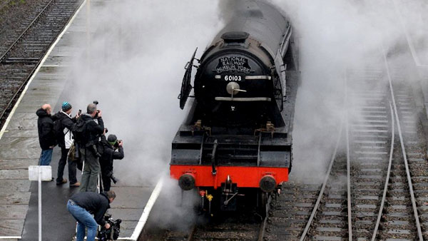 The  Flying Scotsman steam train stands alongside a platform at Bury Bolton  Street rail station in Bury, north west England on January 8, 2016. - AFP