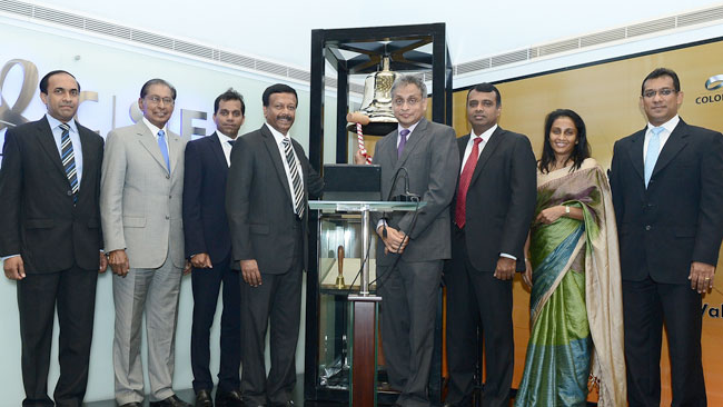 CSE CEO Rajeeva Bandaranaike, CSE Director Moksevi Prelis, LOLC Securities CEO Sriyan Gurusinghe, LOLC Group Managing Director and CEO Kapila Jayawardena, CSE Chairman Vajira Kulatilaka, LOLC Group Chief Operating and Legal Officer Kithsiri Gunawardena, LOLC Group Chief Financial Officer Sunjeevani Kotakadeniya and LOLC Group Chief Information Officer Conrad Dias at the bell ringing ceremony.