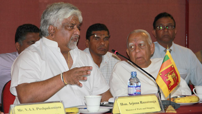 Ports and Shipping Minister Arjuna Ranatunga with Opposition Leader R. Sampanthan at a meeting at  the District Secretariat Auditorium in Trincomalee on Thursday.