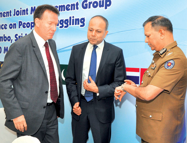 Australian High Commissioner Bryce Hutchinson, Law and Order and Southern Development Minister Sagala Rathnayake with IGP N K Illangakoon. Picture by : Thushara Fernando
