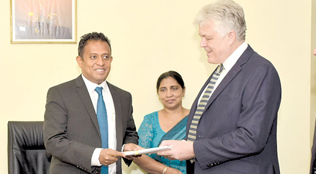 Minister Chandima Weerakkody and Asia Westerngeco Seismic Holdings Limited Vice President Roger Dowdney after signing the  agreement