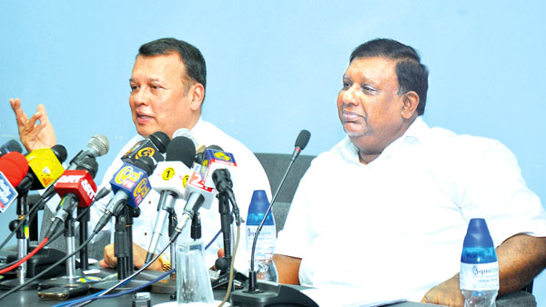 Ministers Samarasinghe and Seneviratne during the media briefing.  Picture by Wasitha Patabendige