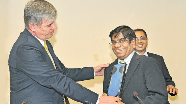 Ambassador Hovorka presenting a token of appreciation to NCCSL President Tilak Godamanne.  Picture by Thushara Fernando