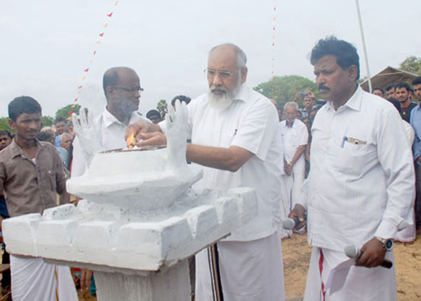 Northern Province Chief Minister C.V. Vigneswaran lighting lamps at Vellamullivaikkal in Mullaitivu