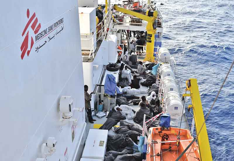 Migrants and refugees prepare to sleep aboard the rescue ship Aquarius Tuesday after a rescue operation. - AFP