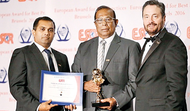 Pussalla Meat Chairman Philip J.Wewita receiving the European Award for Best Practices 2016 From European Society For Quality Research at Switzerland. Pussalla Meat Managing Director Dilshan Wewita looks on.
