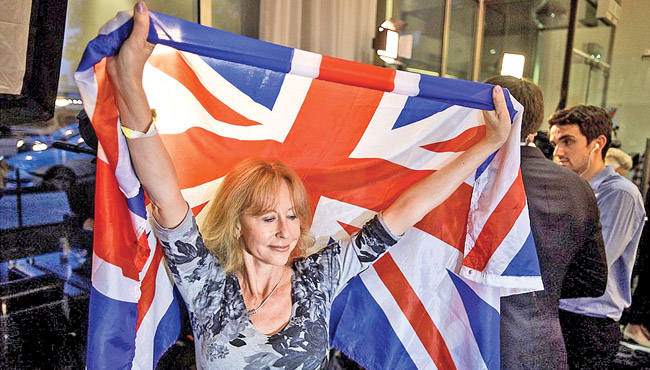 A Leave campaigner celebrates in London amid scenes of utter elation with a commanding lead and just a few areas left to declare.