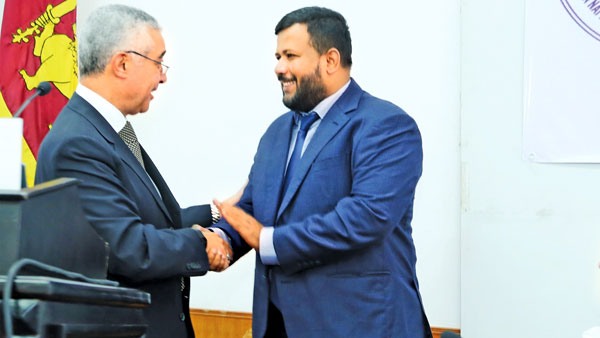 Minister Rishad Bathiudeen with WTO visiting Director Abdel-Hamid Mamdouh.