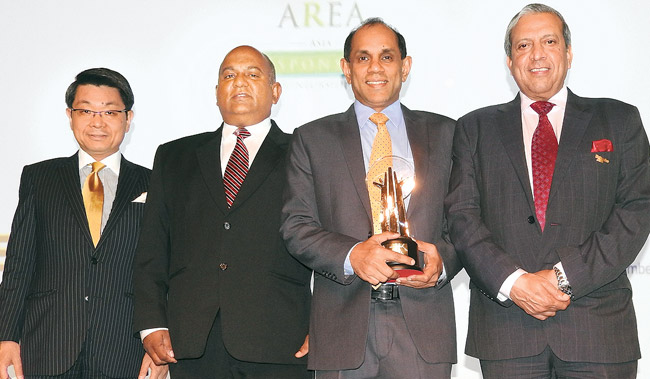 Legal and External Affairs Director, CTC,  Dinesh Dharmadasa and CSR Manager, CTC, Senaka De Fonseka with the Asia Responsible Entrepreneurship Award from Enterprise Asia