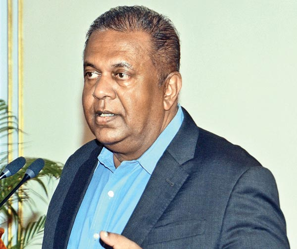 Foreign Affairs Minister Mangala Samaraweera speaking at yesterday's press conference.  Picture by Wimal Karunathilake