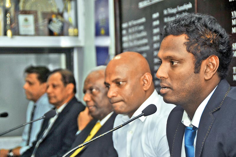Sri Lanka captain Angelo Mathews addressing the media at the SLC headquarters yesterday after his team had returned from a tour of UK. Chief selector Sanath Jayasuriya, SLC vice president Jayantha Dharmadasa and SLC secretary Mohan de Silva are also present. Picture by Rukmal Gamage