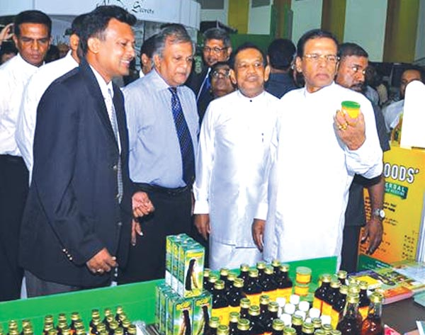 The annual Ayurveda Expo 2016 organised by the National Chamber of Commerce in partnership with the Ministry of Health, Nutrition and Indigenous Medicine concluded at BMICH last week.   Here President Maithripala Sirisena who was the Chief Guest  at a stall with  Health Minister Rajitha Senarathne and other officials. Picture by Sudath Malaweera