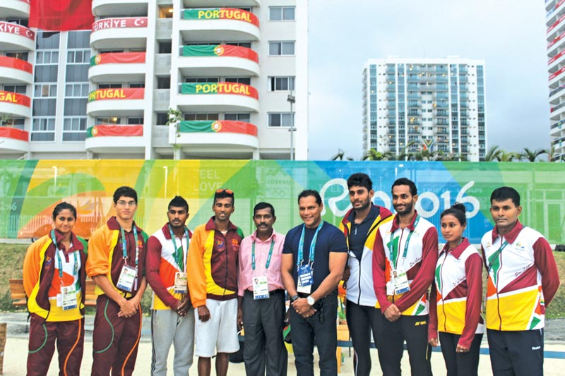 Sports Minister Dayasiri Jayasekera, accompanied by Director General of Sports Saman Bandara pose with the Sri Lankan Olympic contingent at Olympic Village in Rio.