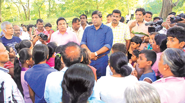 Finance Minister Ravi Karunanayake in discussion with the Wilachchiya villagers.PICTURE BY- ANURADHAPURA CENTRAL GROUP CORR.