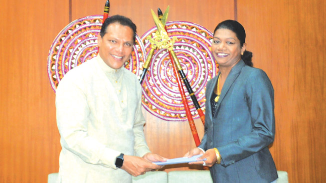 Susanthika Jayasinghe receiving her appointment letter from Sports Minister    Dayasiri Jayasekera, who arrived in the country after participating in Rio   Olympics, in Brazil.