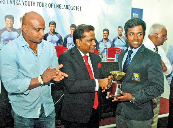 Sri Lanka Cricket president Thilanga Sumathipala and chief selector Sanath Jayasuriya with Sri Lanka Under 19 captain Charith Asalanka who displays the trophy his team won for winning the U19 Youth test series against England.