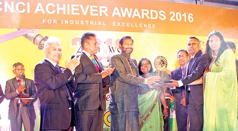 Link Natural Products receiving their Gold award from Primary Industries Minister Daya Gamage at the CNCI Achiever Awards ceremony. Picture by Sulochana Gamage