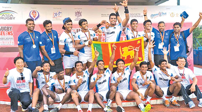 The victorious Sri Lanka team celebrates winning the U18 Rugby Sevens Cup championship in Chinese Taipei.