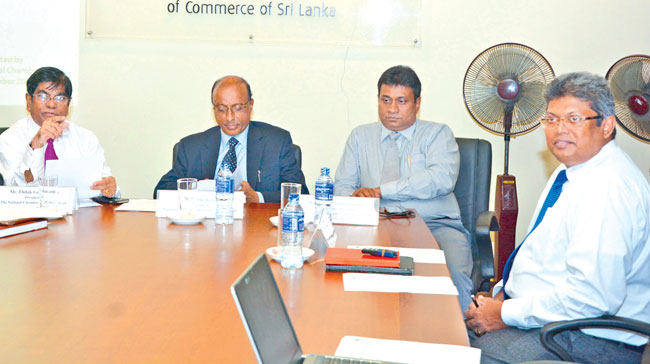 National Chamber of Commerce (NCC) President Thilak Godamanna,NCC Secretary General Bandula Dissanayake and NEDA Chairman and Director General Omar Kamil at the press briefing. Picture by  Malan Karunaratne