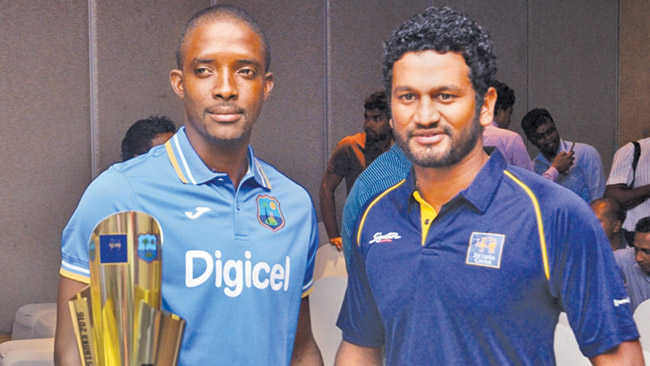 Sri Lanka 'A' skipper Dimuth Karunaratne (right) and West Indies 'A' captain Shamarh Brooks with the trophy that will be awarded to the winners of the unofficial test series at the JAIC Hilton yesterday. Picture by Wimal Karunathilaka