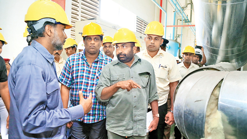 Power and Energy Minister Ranjith Siyambalapitiya and Deputy Minister  Ajith P. Perera on an inspection tour at  the Norochcholai plant yesterday