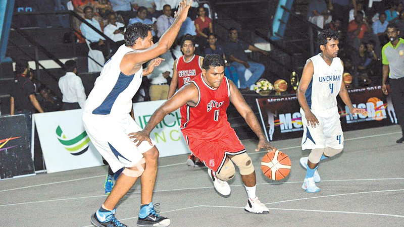 The men's 'D' division final between Seylan Bank and Union Bank.