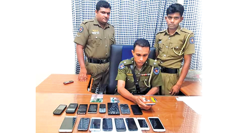 Police with seized mobile phones