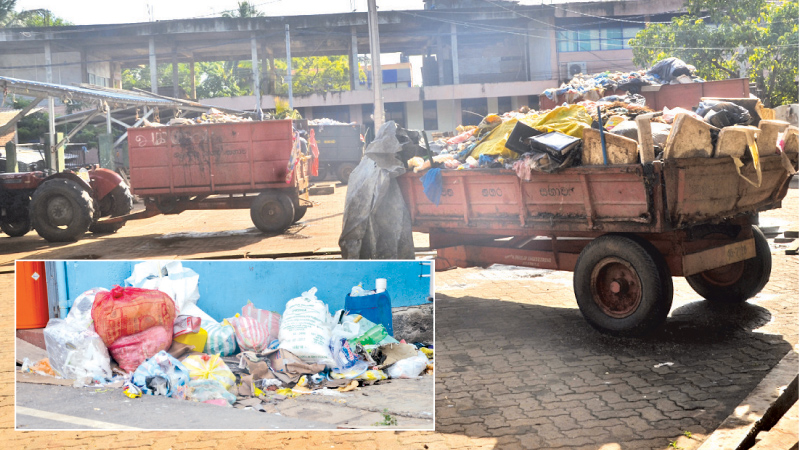 Tractors loaded with garbage and uncleared garbage seen everywhere in the town