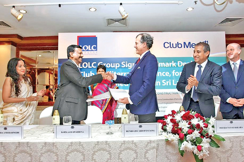 The agreement being exchanged between LOLC Group Managing Director and CEO Kapila Jayawardena and Club Mediterranee President and CEO Henri Giscard d'Estaing. LOLC Group was represented by Deputy Chairman Ishara Nanayakkara, Directors  K. Amarasinghe and Kamantha Amerasekera and Consultant Director of the Leisure Division Ajit Jayemanne while Club Med was represented by Xavier Desaulles and Marc De Jouffroy.  Picture by Shan Rambukwella