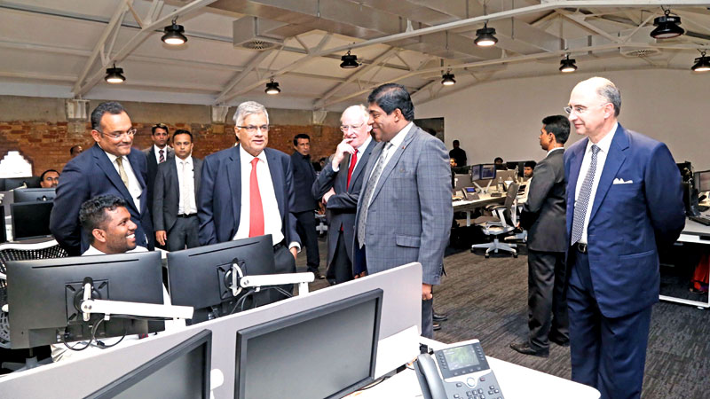 Prime Minister Ranil Wickremesinghe at the LSEG facility yesterday with LSEG Chairman Donald Brydon, Minister of Finance, Ravi Karunanayake at the site. Picture by Nirosha Batepola