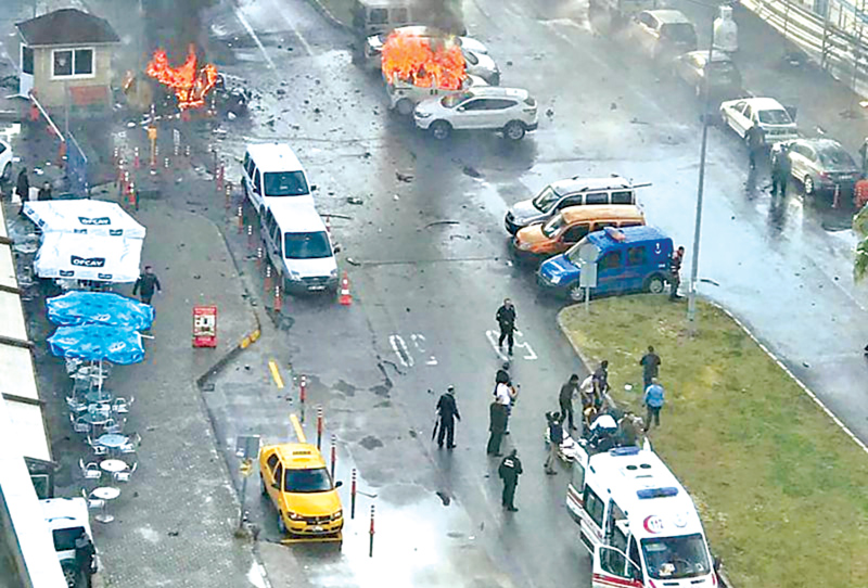 Cars burn in the street at the site of an explosion in front of the courthouse in the western Turkish city of Izmir.- AFP