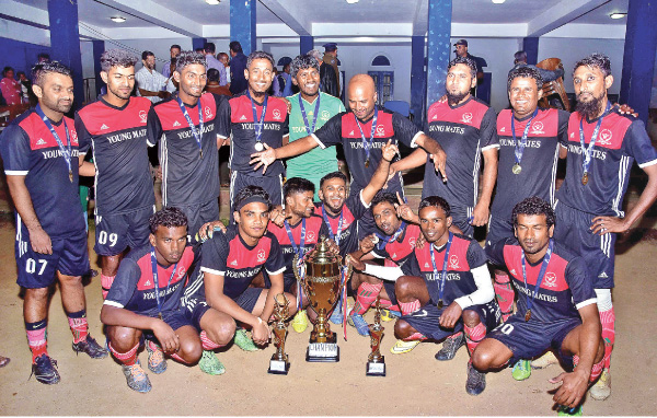 Champion Young Mates SC team with their trophies