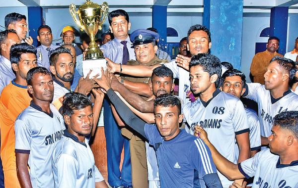Runner-up Sripadians SC receiving the trophy