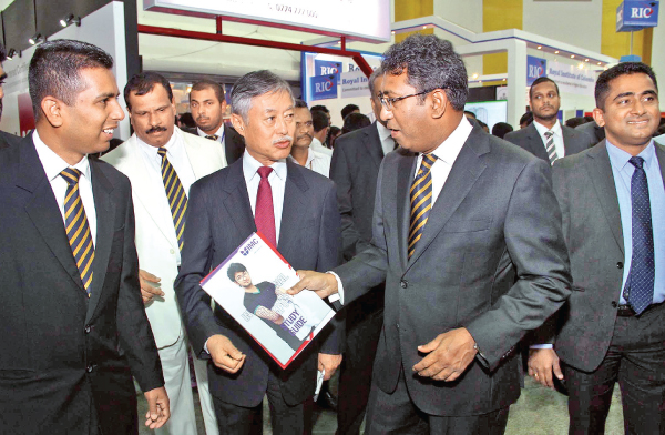 Foreign Affairs Acting Minister Dr. Harsha de Silva with the EDEX magazine with a group of Royalists at the RCU stall. Picture by Sulochana Gamage