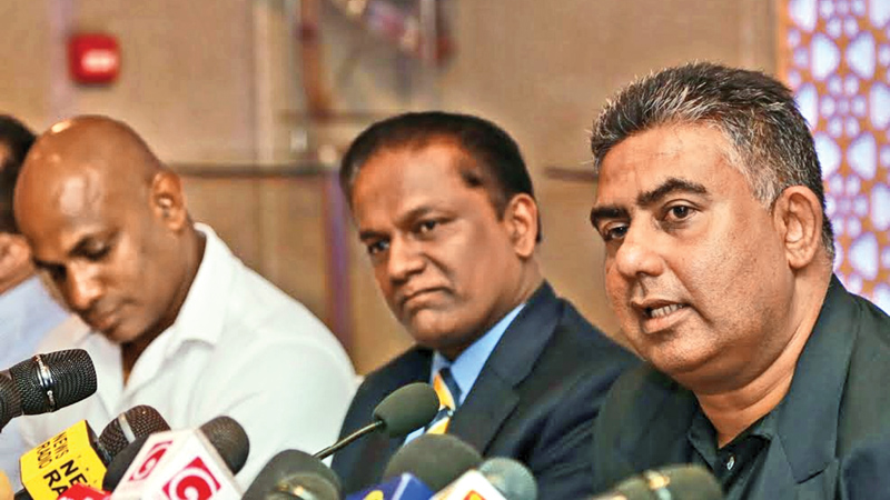 Former Sri Lanka cricketer Asanka Gurusinha addresses the media at the JAIC Hilton yesterday. SLC president Thilanga Sumathipala and chairman of selectors Sanath Jayasuriya are also present. Gurusinha has undertaken on a new role as Sri Lanka Cricket Manager for three years. Picture by Rukmal Gamage