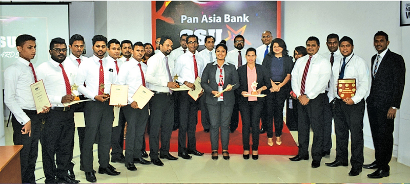 The Best Sales Team - Cards and BT sales and all winners with the bank's acting CEO Lalith Jayakody.
