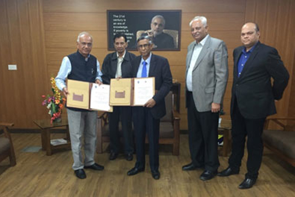 The signed MoU displayed by the Director General GFSU Dr. J. M. Vyas and Prof. Lakshman R Watawala, President CMA Sri Lanka together with Dr. M.S. Dahiya, Director, Institute of Forensic Science -  GFSU, C D Jadeja, Registrar GFSU and Ravish Shah, International Relations Office GFSU.