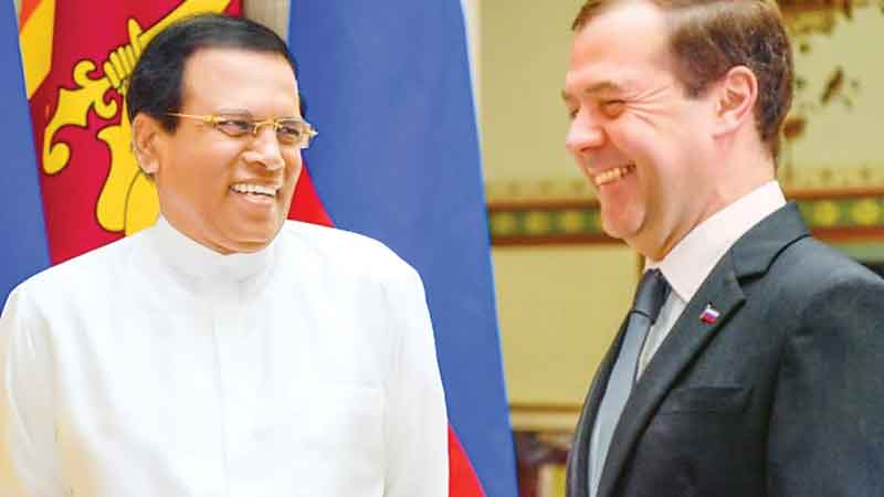 President Maithripala Sirisena meeting Russian Prime Minister Dmitry Medvedev yesterday. Picture by Sudath Silva
