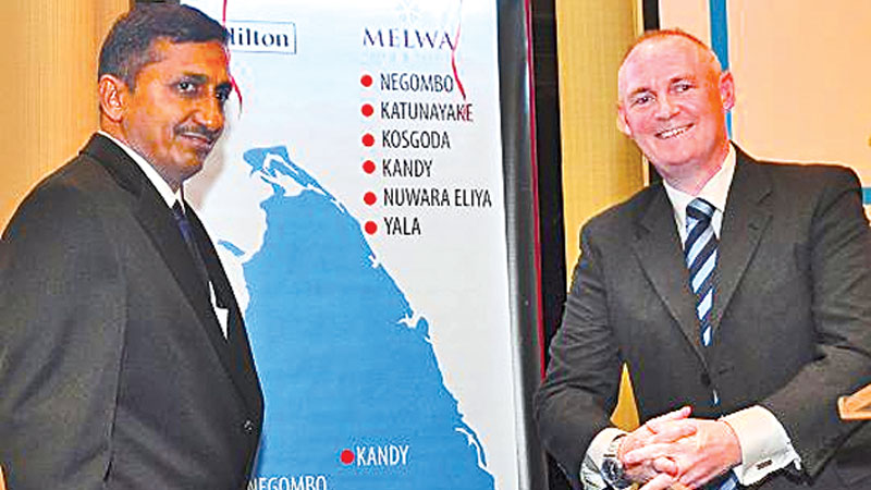 Melwa Hotels And Resorts Director T P Anandaraja Unveiling The Hilton Hotel Chain Map In Sri Lanka With S South East Asia India Vice President