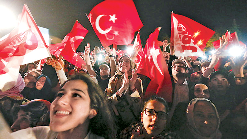 Erdogan supporters celebrate in Istanbul on Sunday.