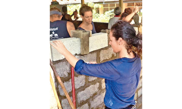 Foreign women engaged in construction works.