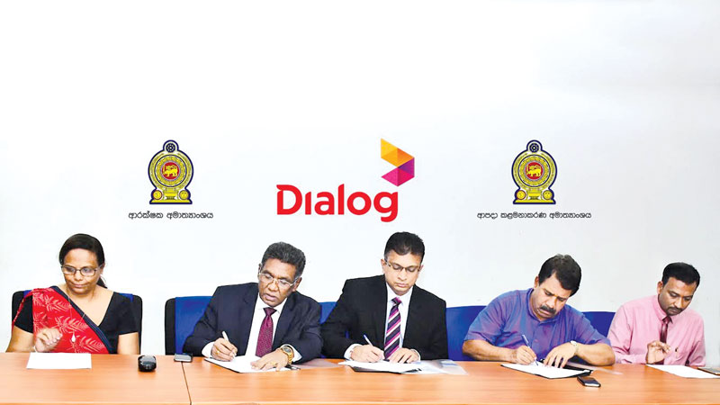 The programme partners with the Disaster Relief Effort. Here the signing of the agreement. From left: Amali Nanayakkara, Group Chief Marketing Officer, Dialog Axiata PLC, Engineer Karunasena Hettiarachchi, Secretary Ministry of Defence, Supun Weerasinghe, Group Chief Executive, Dialog Axiata PLC, S.S. Miyanwala, Secretary Ministry of Disaster Management and Champika Wijesooriya, Media Secretary, Ministry of Disaster Management.